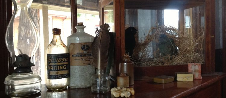 On display in the 1877 room are large ceramic ink bottles and knuckle bones