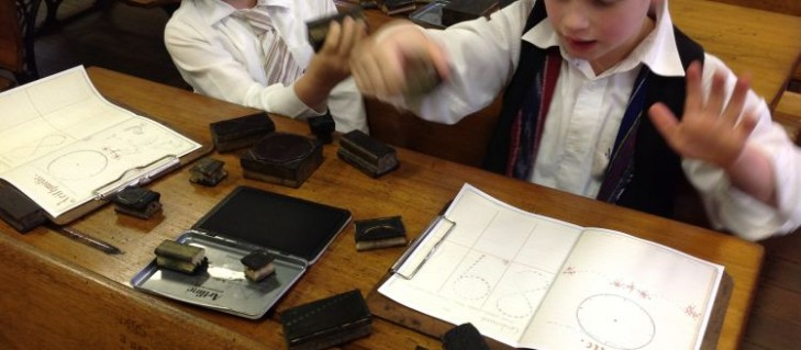 Students use old rubber stamps of numbers and clock faces