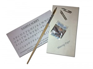 Pen and ink set contains a pen, three nibs, ink powder, blotting paper and a page of script