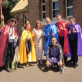 The Wiggles posing outside Schoolhouse Museum