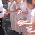 Museum teacher inspecting hands