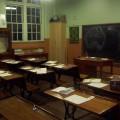 1910 room with school books open on desks.