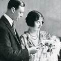 King George VI and Elizabeth Bowes-Lyon holding newly born Elizabeth.