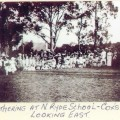 """School photo of students, parents and teachers with the label """"gathering at N Ryde School -Cox's Rd Looking East."""
