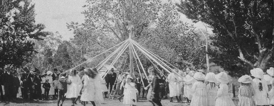 Students dancing around the maypole.