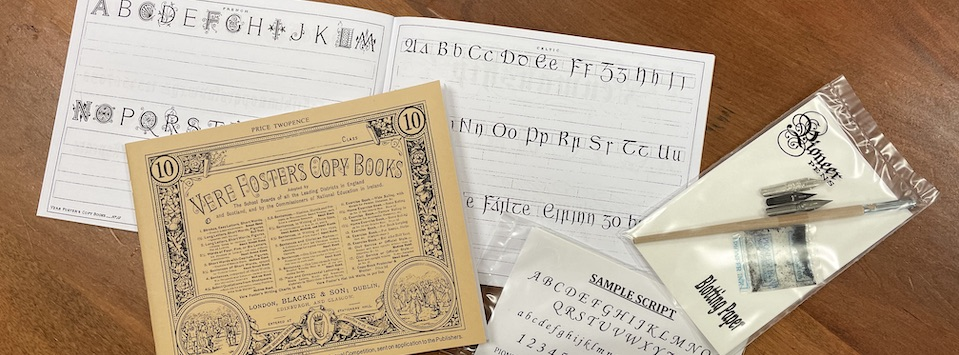 Copy books used in handwriting classes with equipment needed. Pen, nibs and blotting paper